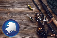 alaska map icon and fishing rods and reels