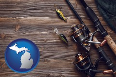 michigan map icon and fishing rods and reels
